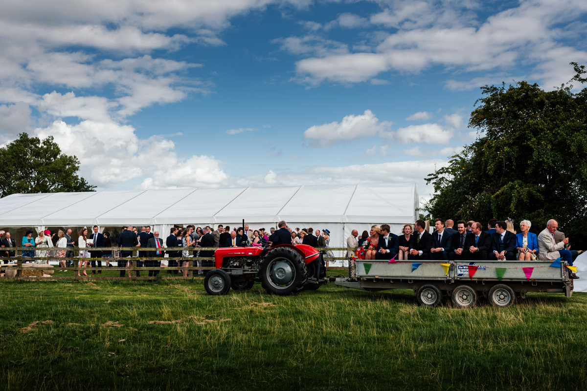 guests arrive from the church on vintage tractors and trailers