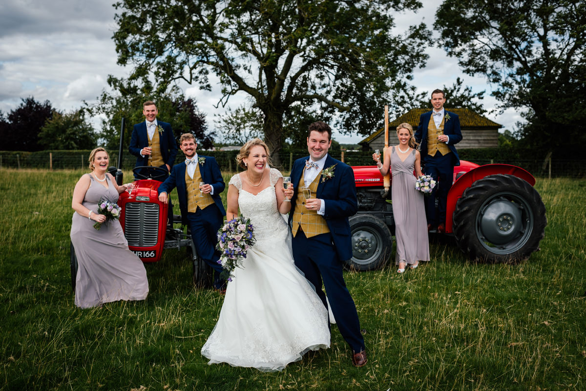 bridal party group photo with vintage tractors