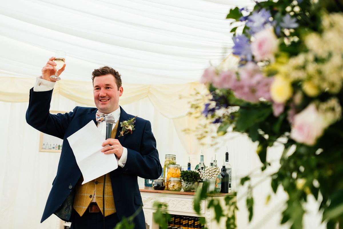 groom giving his speech on wedding day