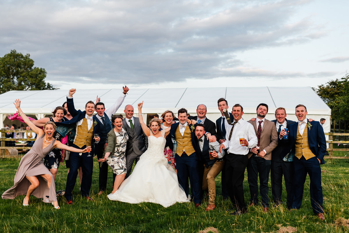 bride and groom with their group of friends