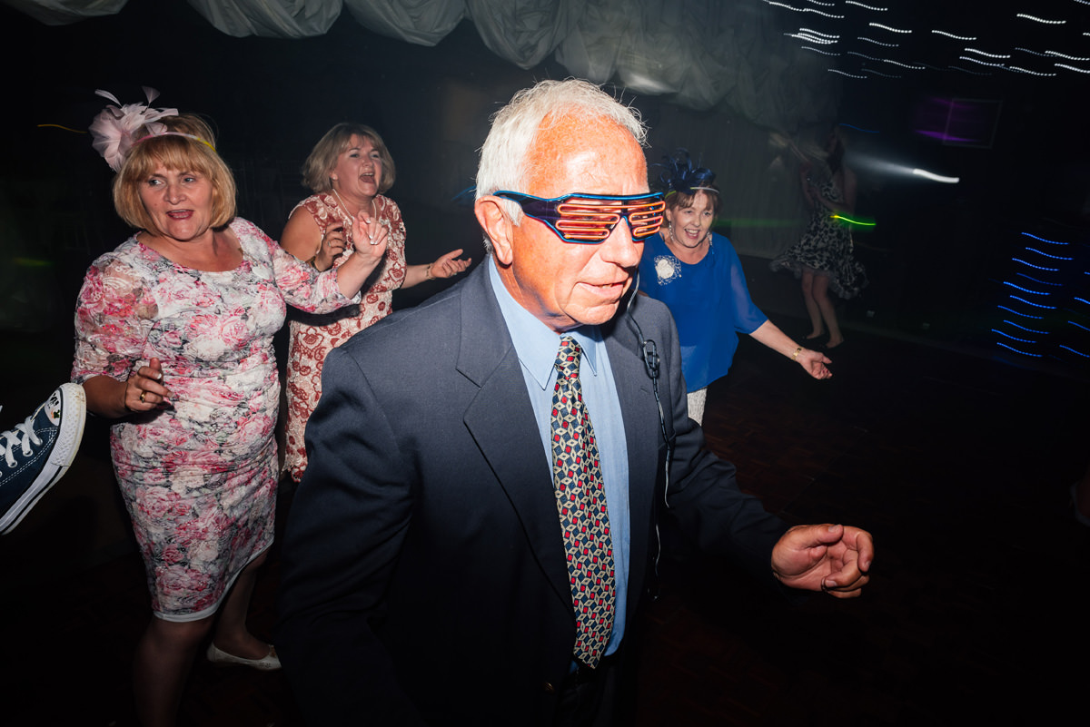 cool dude on the dance floor with funky 80s glasses