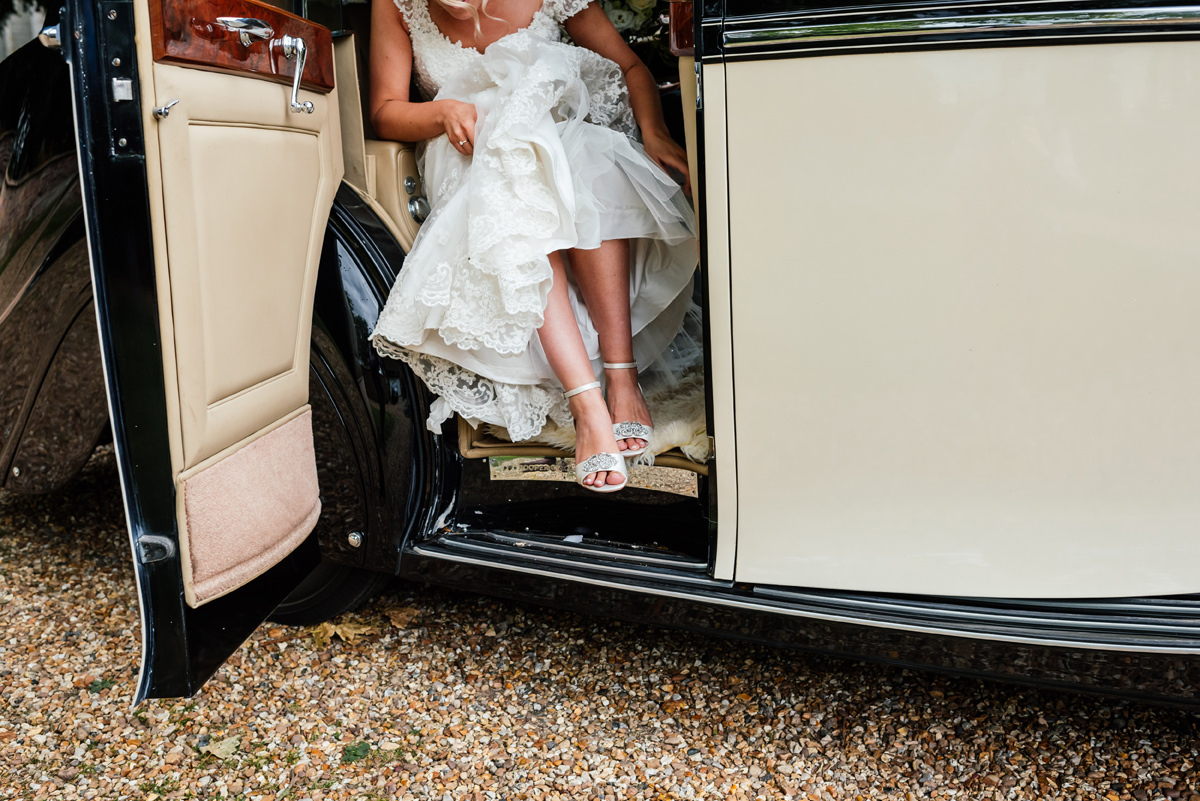 bride gets out of the vintage wedding car