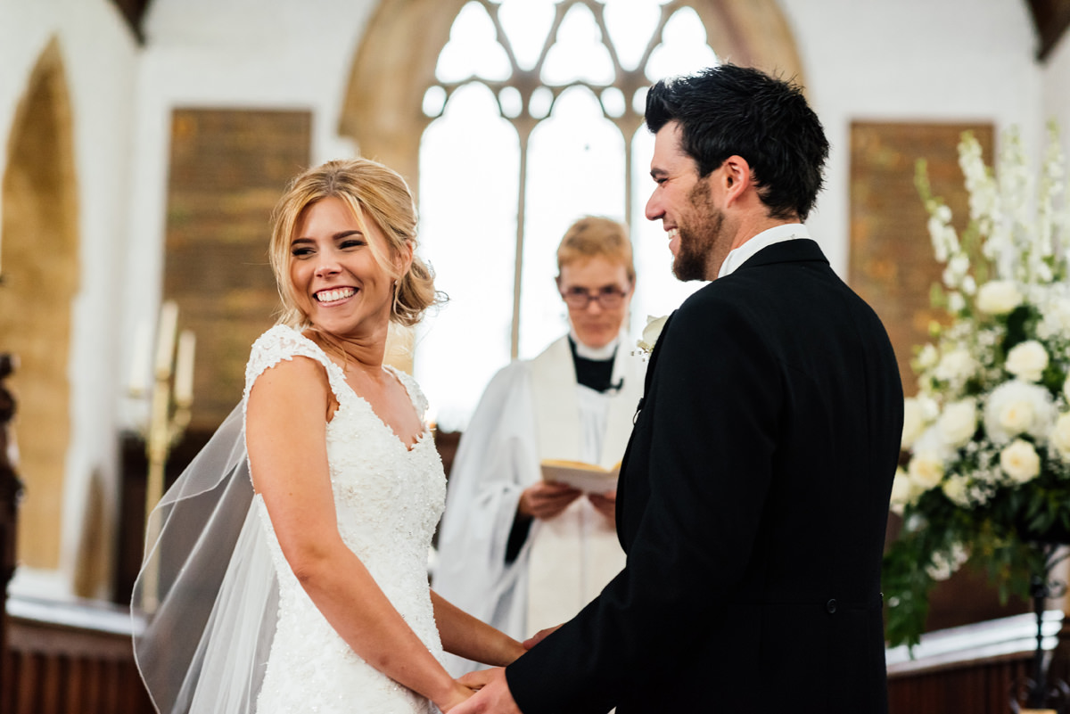 a smiling bride during the wedding ceremony in church