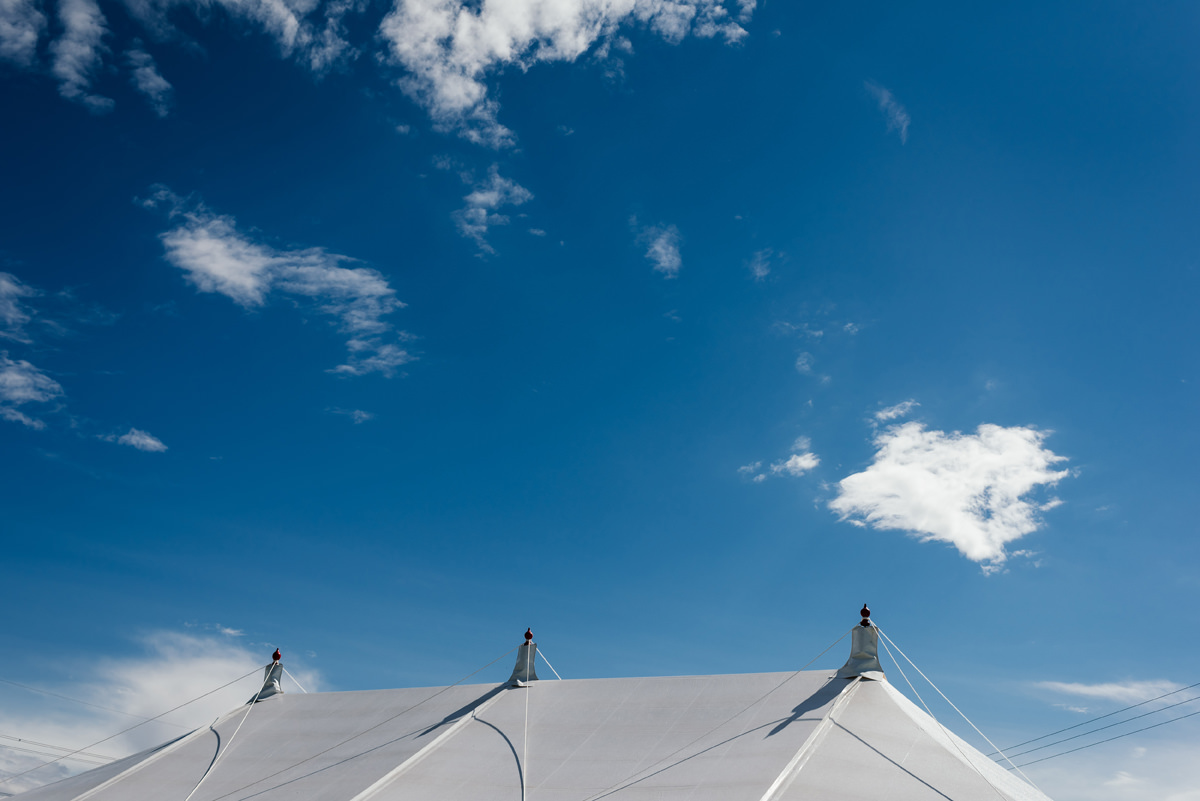 blues skies and wedding marquee