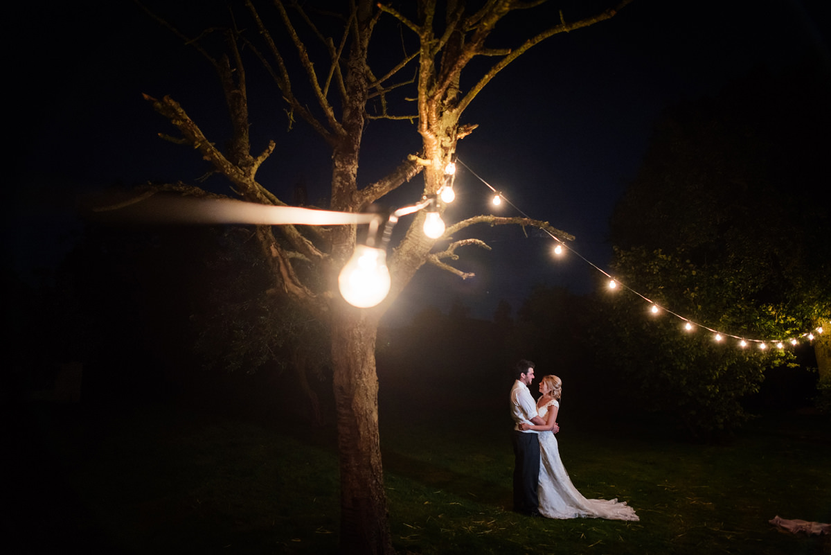 festoon wedding lighting with bride and groom portrait