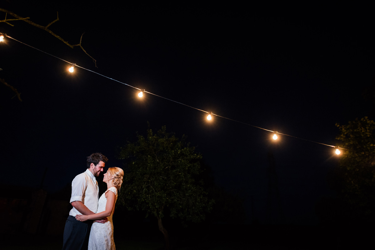 night time bride and groom portrait festoon lighting