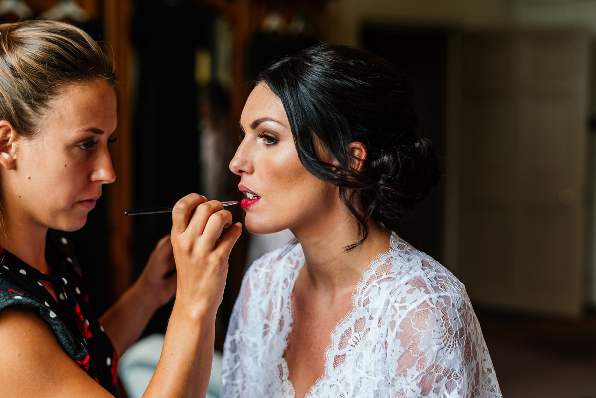 bride having makeup applied.