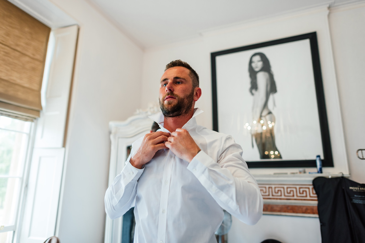 groom getting ready on morning of his wedding