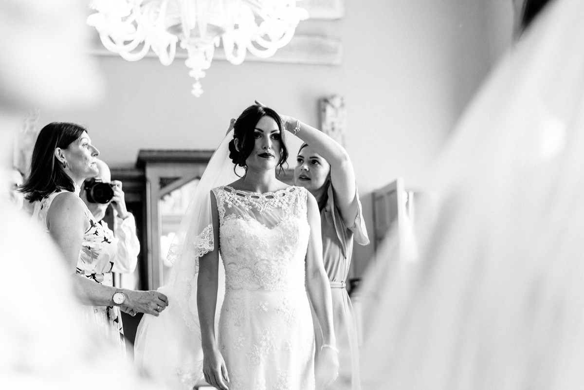bride having her veil put in place