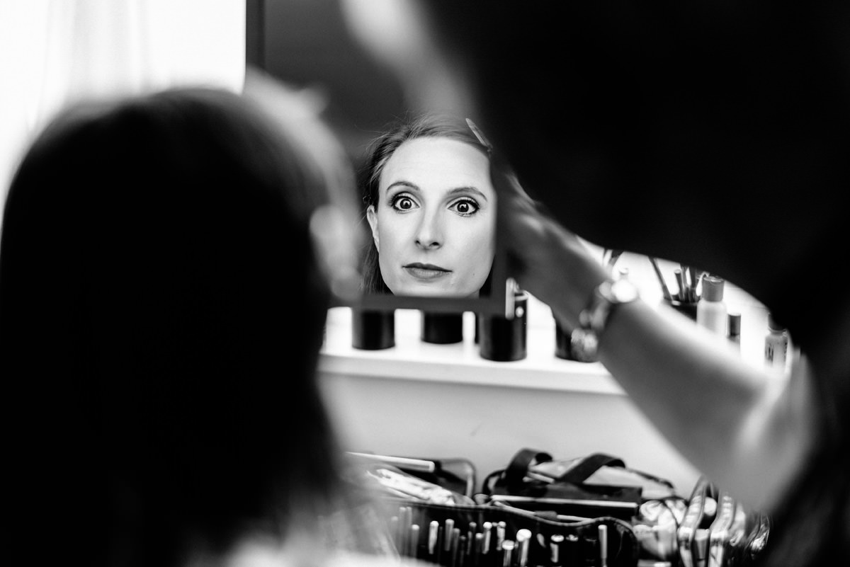 wedding guest having make-up done.