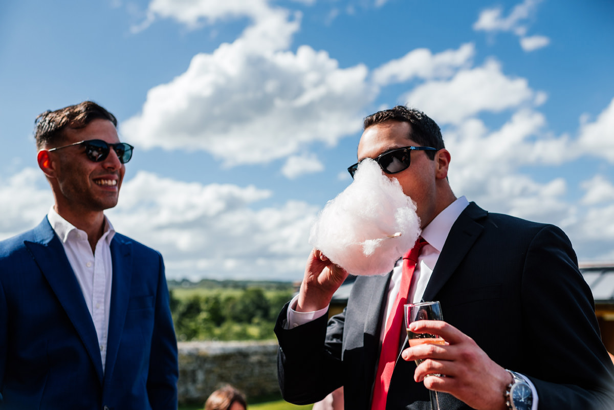 guests eating candy-floss