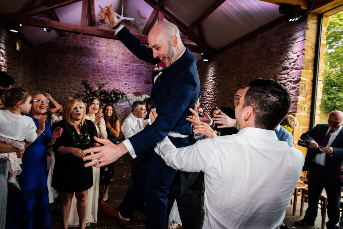 groom doing jewish dancing