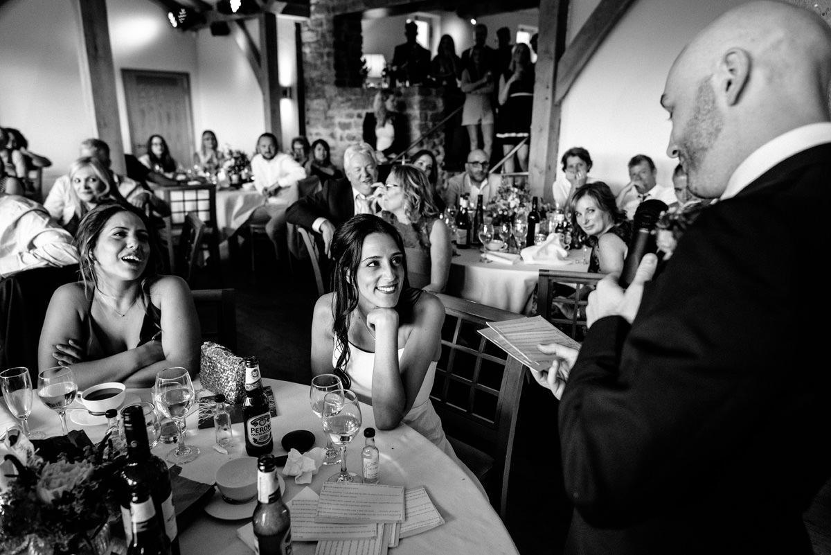 bride listening to her groom during speech