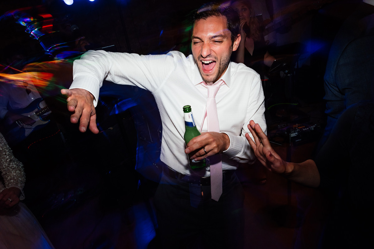 wedding guest throwing shapes on the dance floor