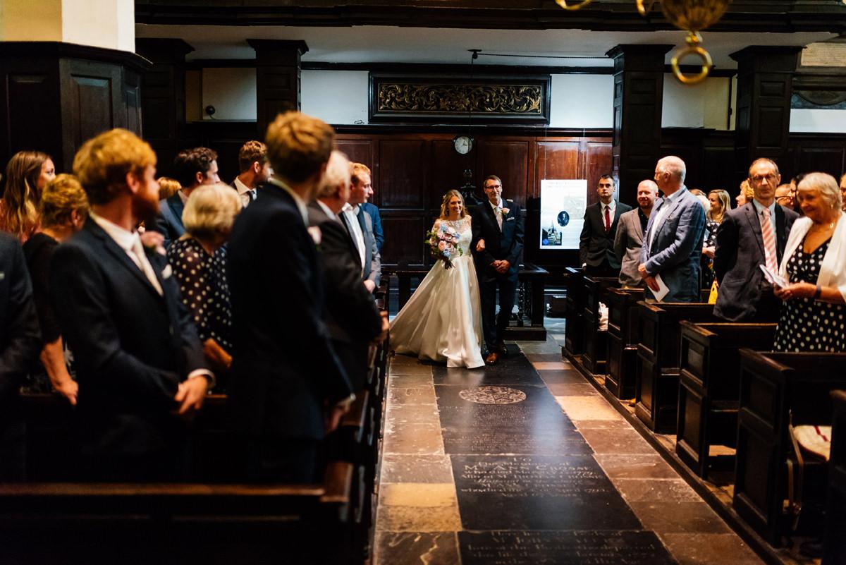 bride walking into the church