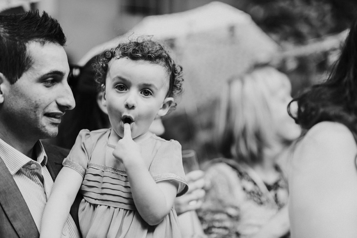 young wedding guest pulling funny face at wedding
