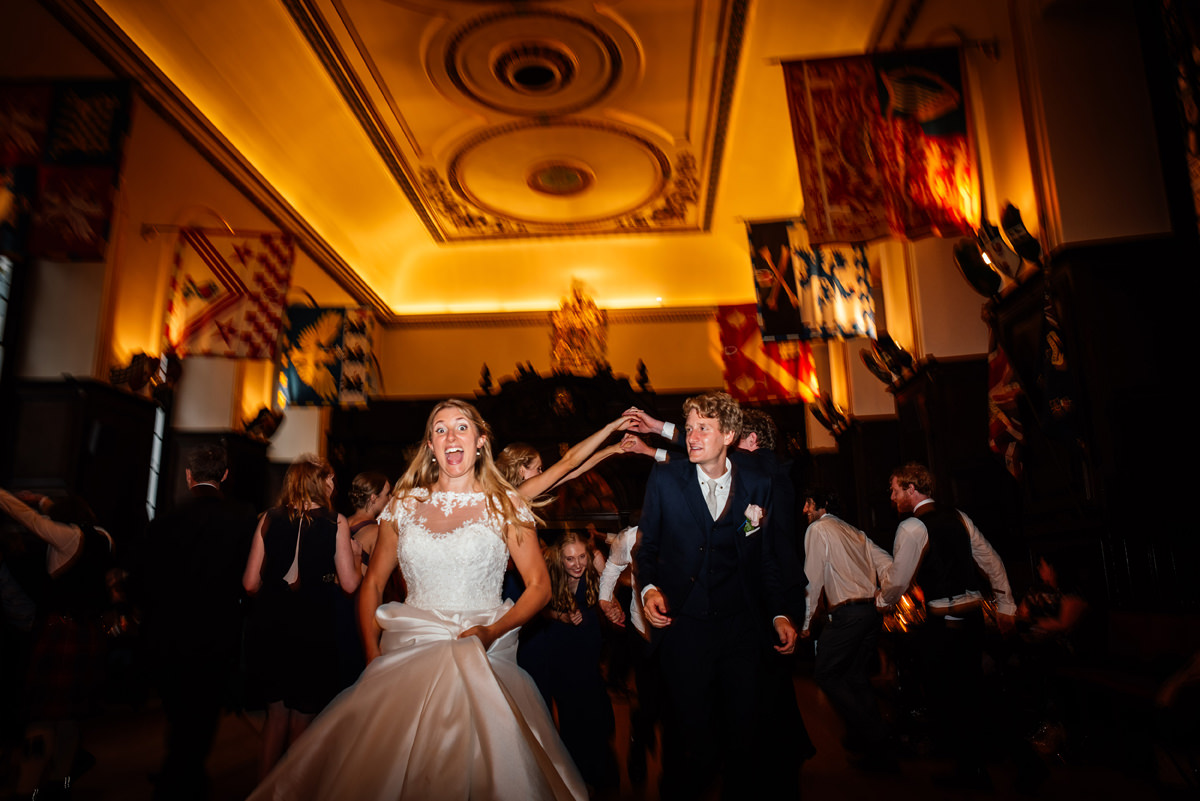 bride and groom dancing a ceilidh