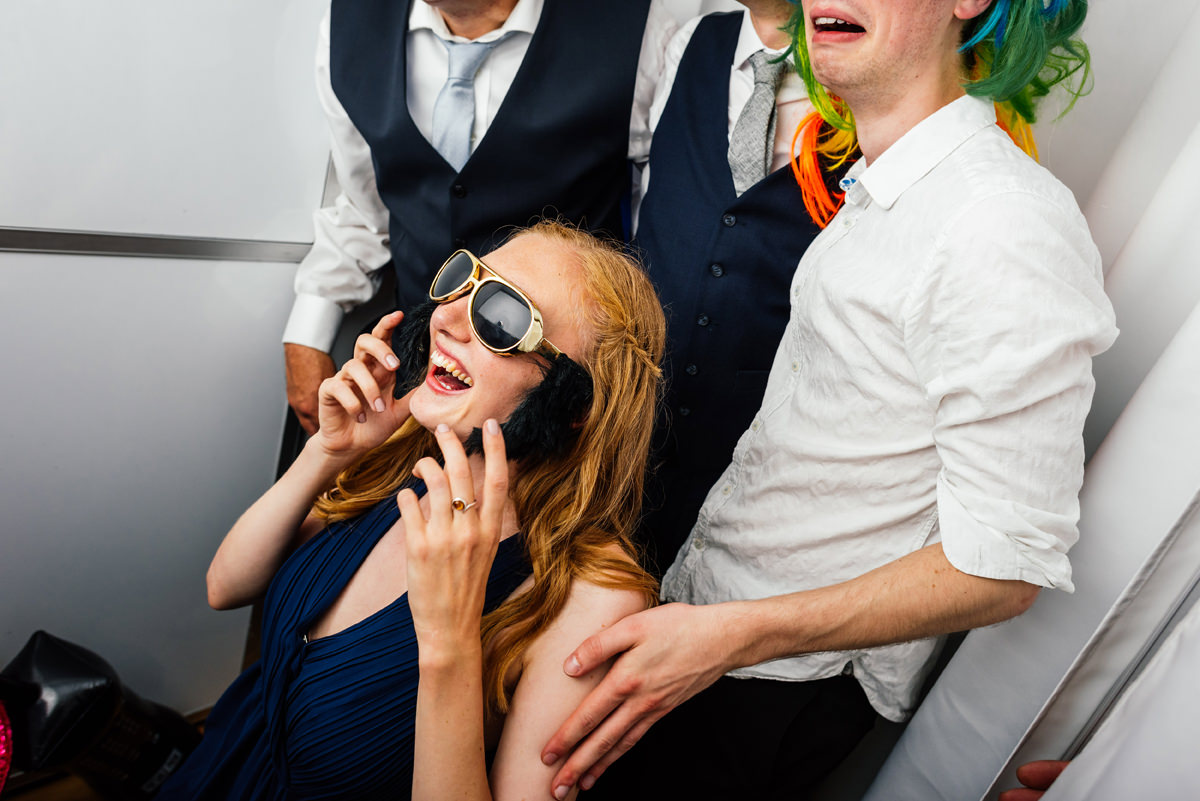 wedding guests having fun in the photo booth
