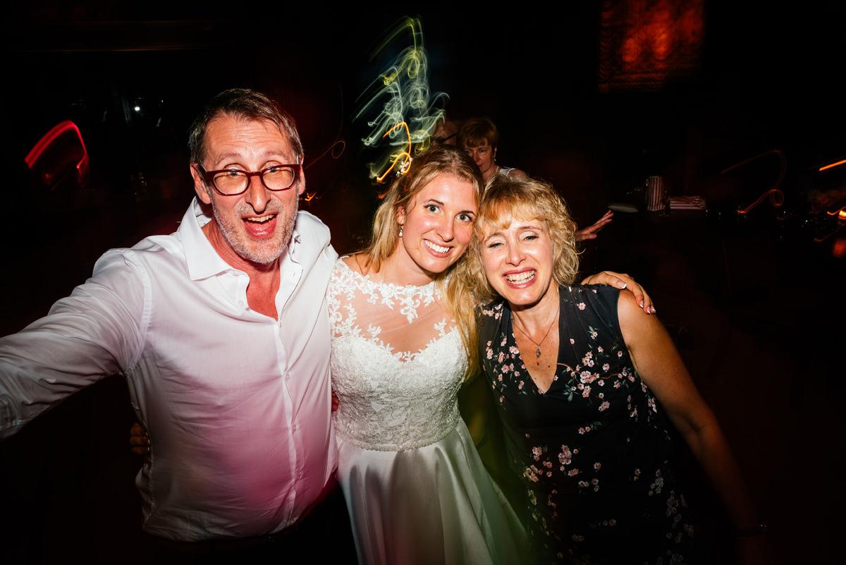 wedding guests having fun on the dance floor