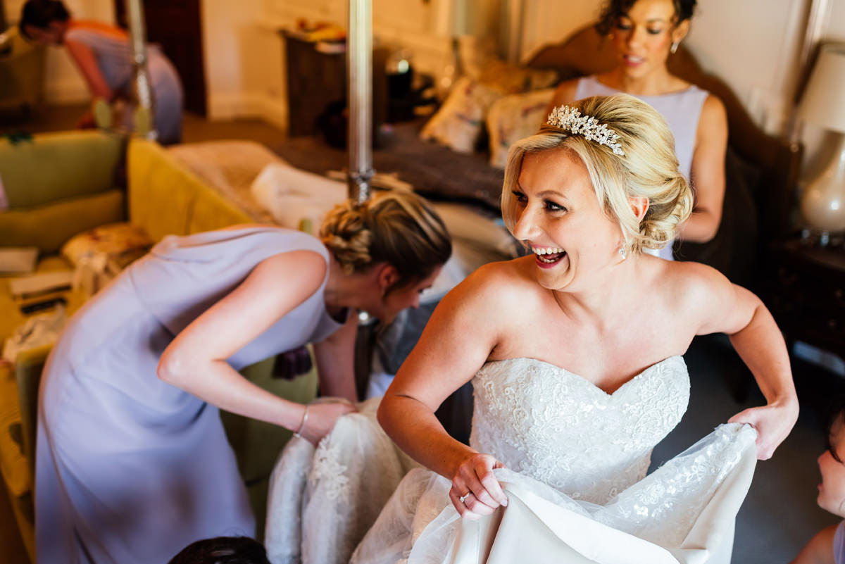 bride getting into her dress
