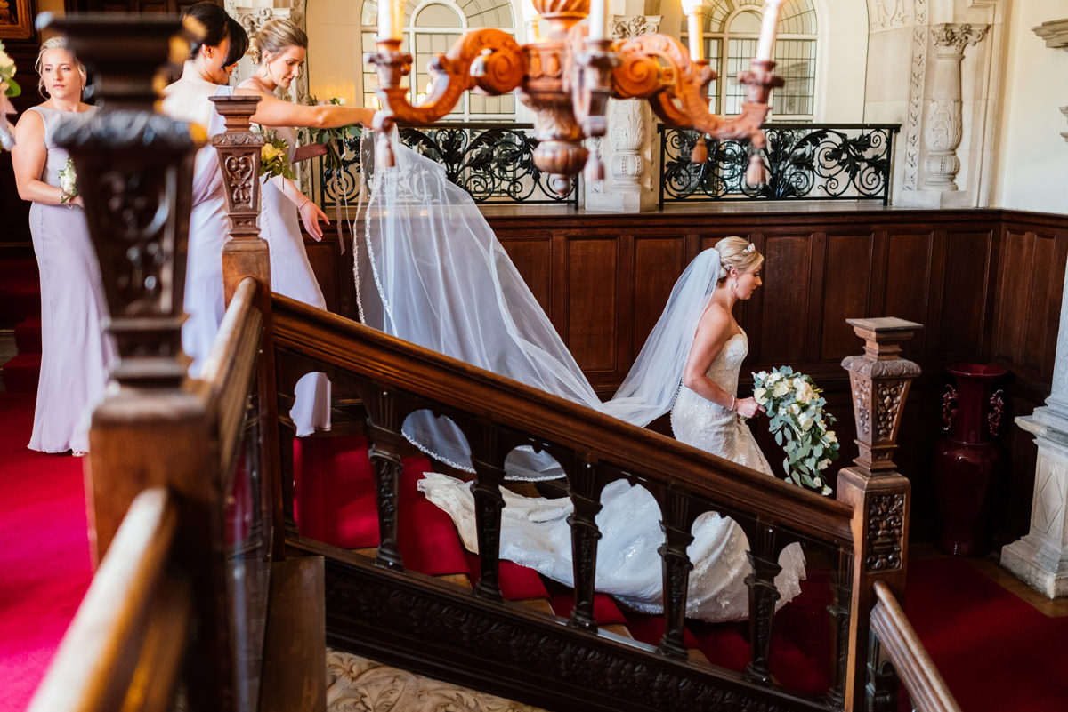 bride heading down stairs at rushton hall