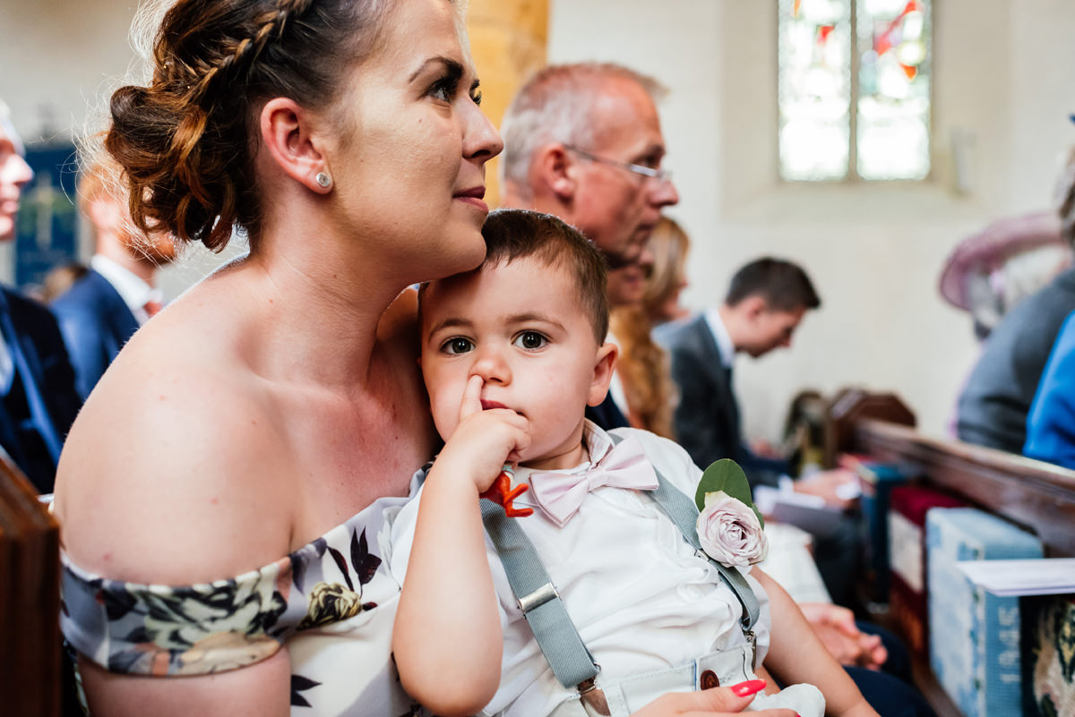child picks his nose in church