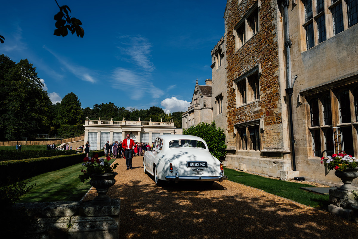 toastmaster greeting bride and groom arriving at the orangery