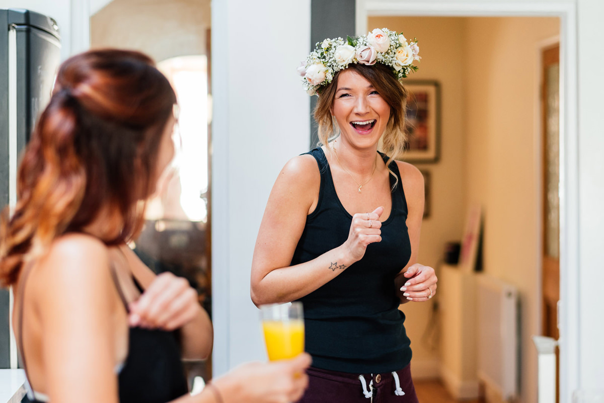 bride in the morning of wedding wearing flower crown
