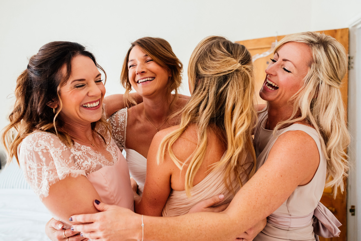 bridesmaids hug it out