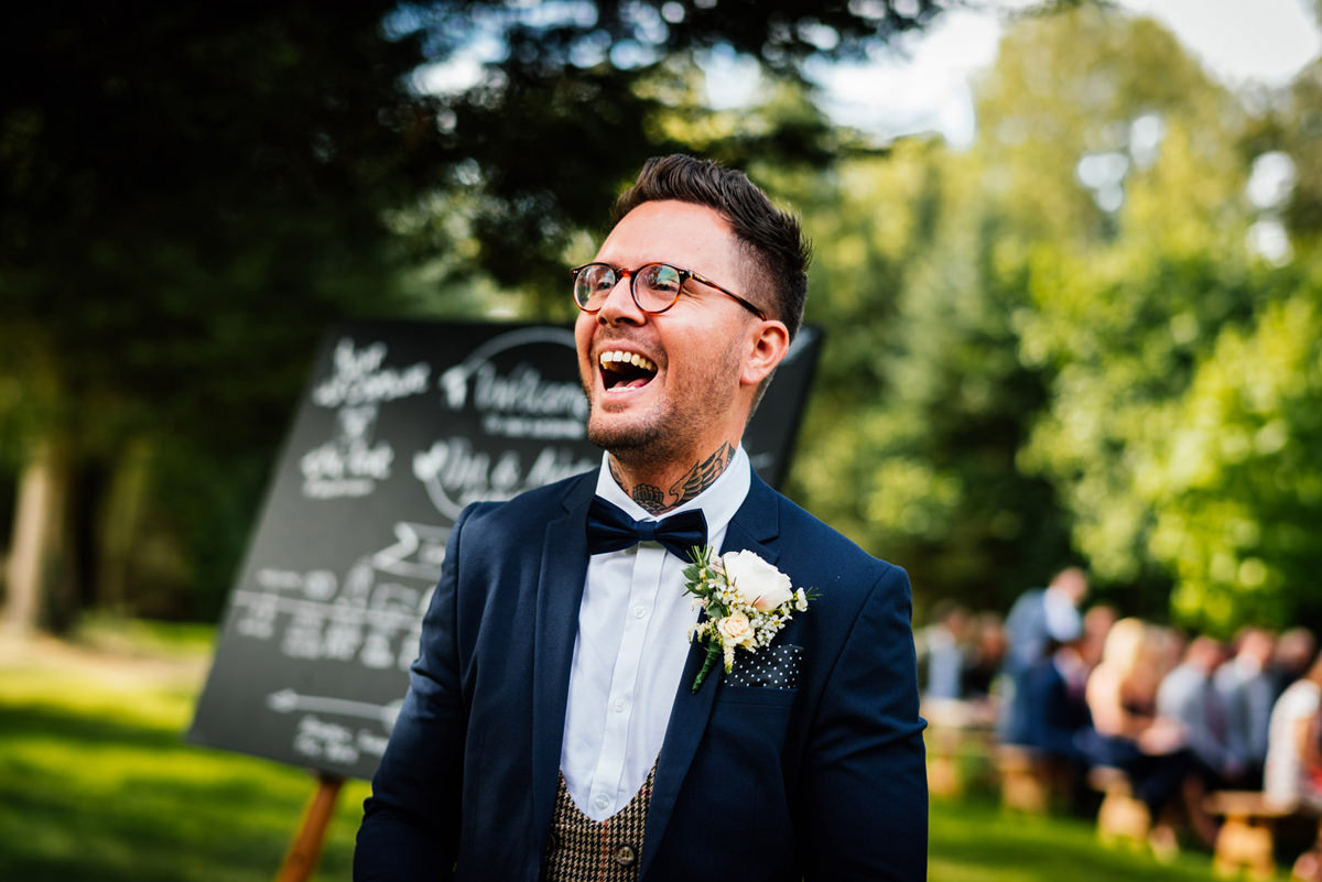 groom laughing before ceremony