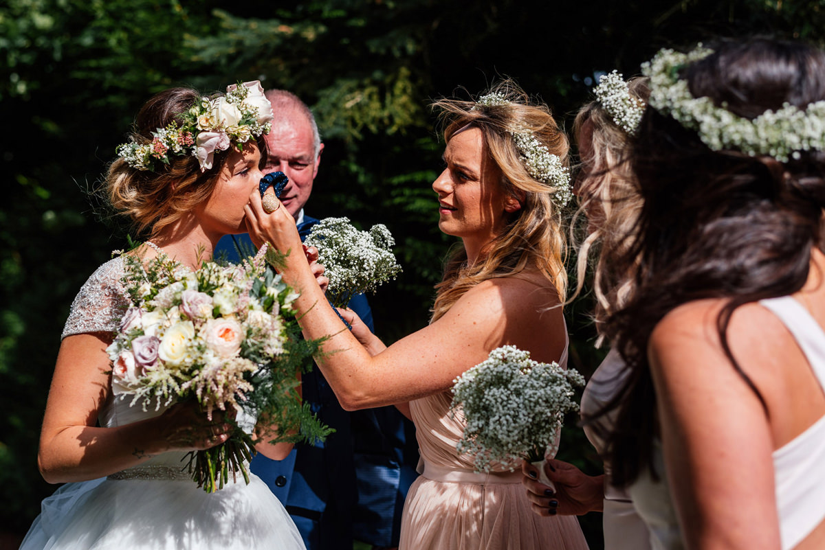 maid of honour wiping bride's tears