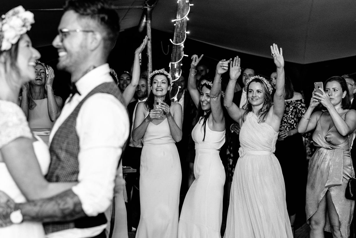 bridesmaid cheering during the first dance