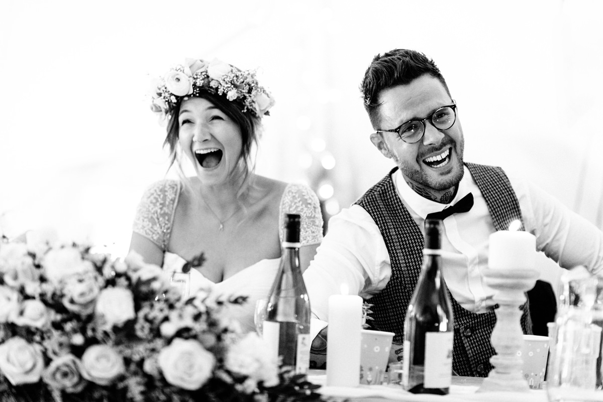 bride and groom laughing during the speeches