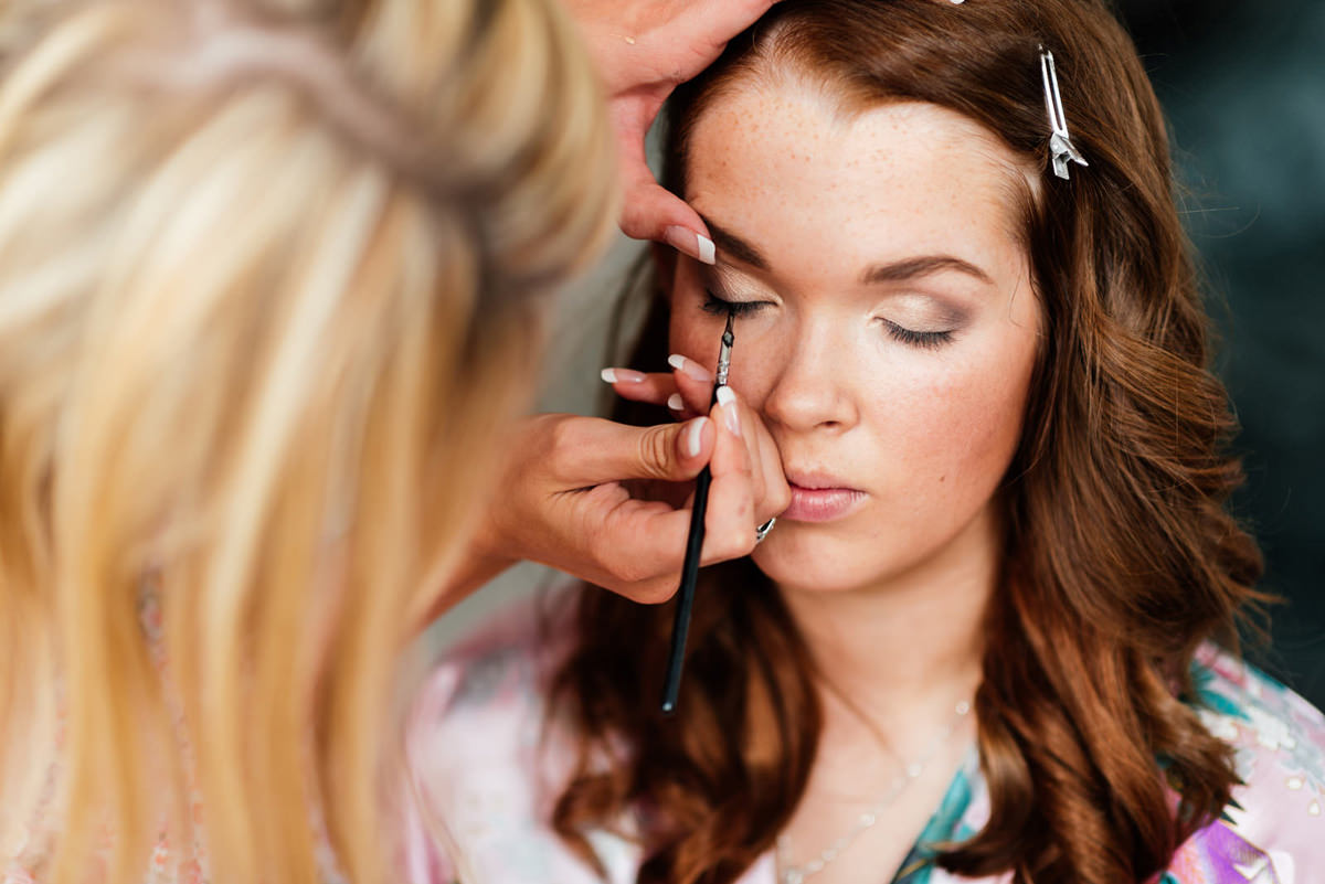bridesmaid having makeup