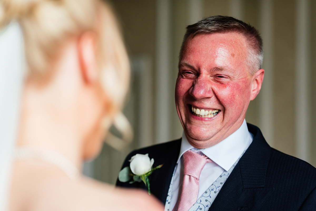dad see his daughter for the first time in her wedding dress