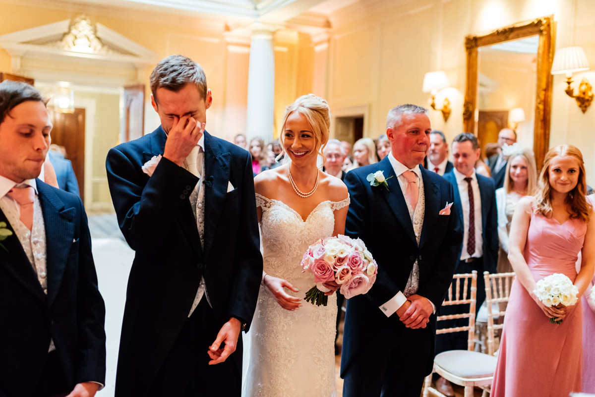 groom emotional as his bride arrives