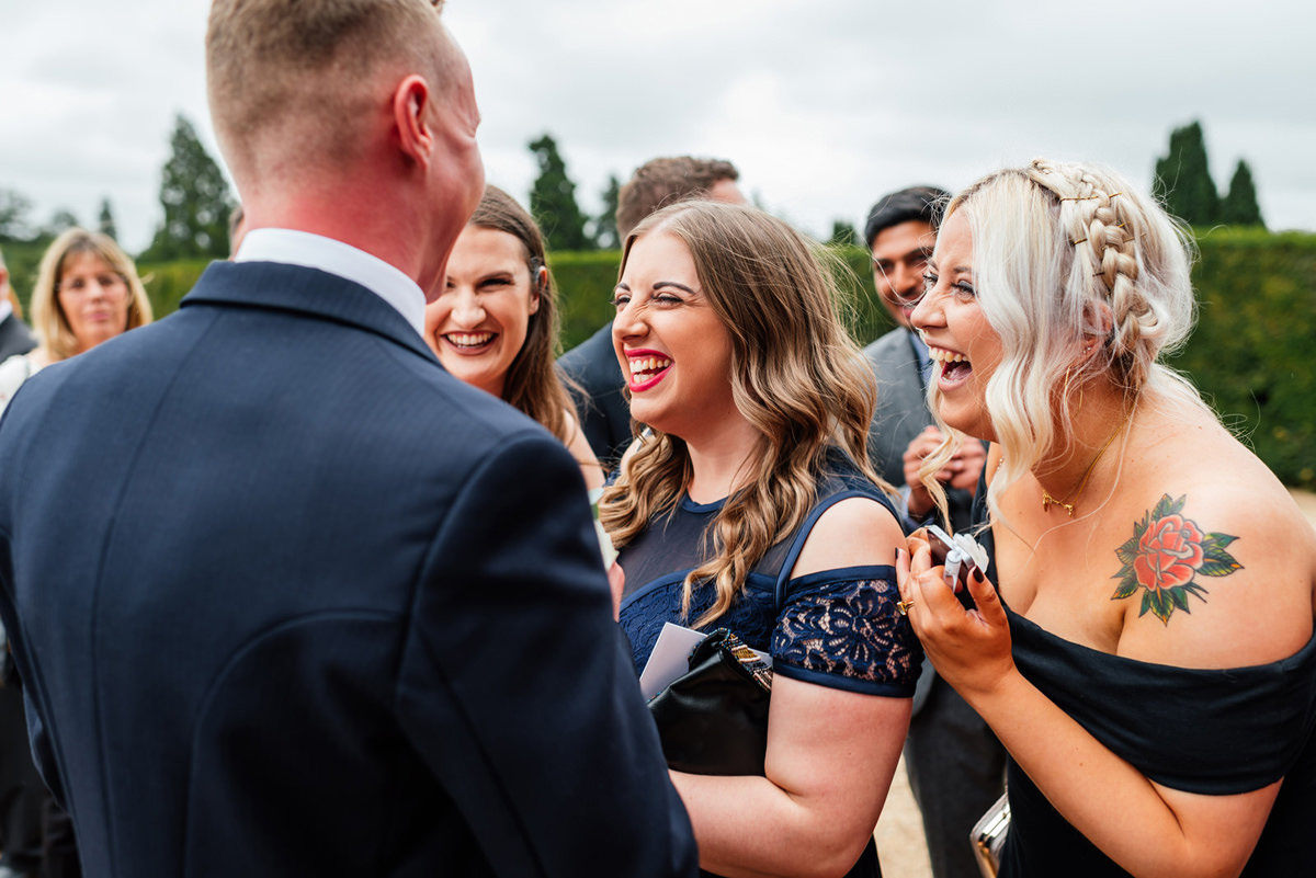 wedding guests laughing during the drinks reception