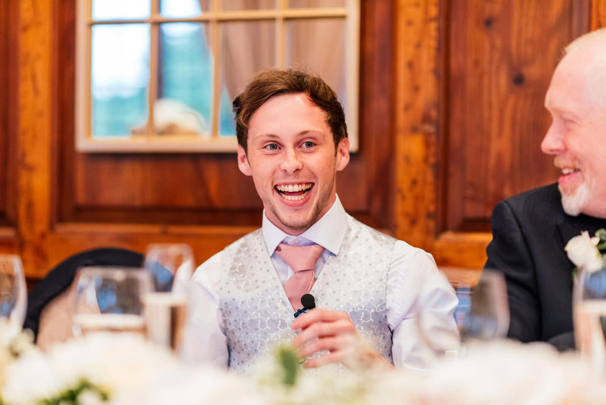 best man laughing during the speeches