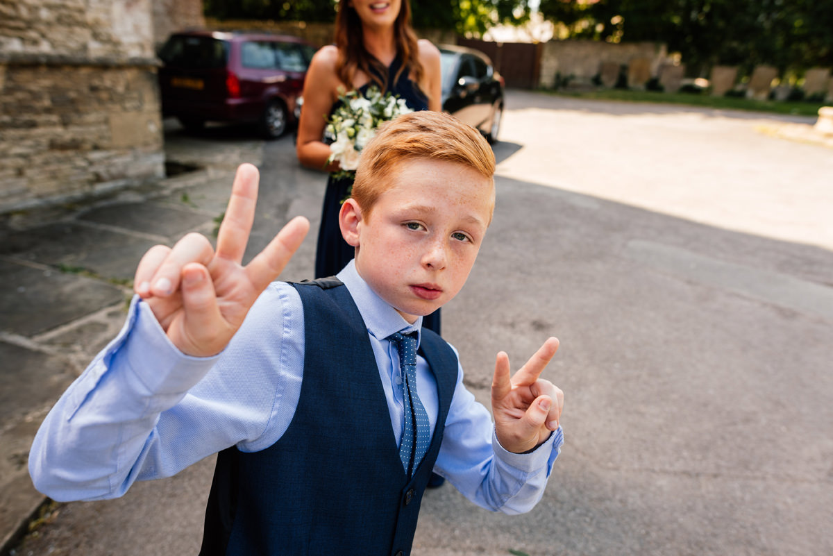 young wedding guest being a little dude