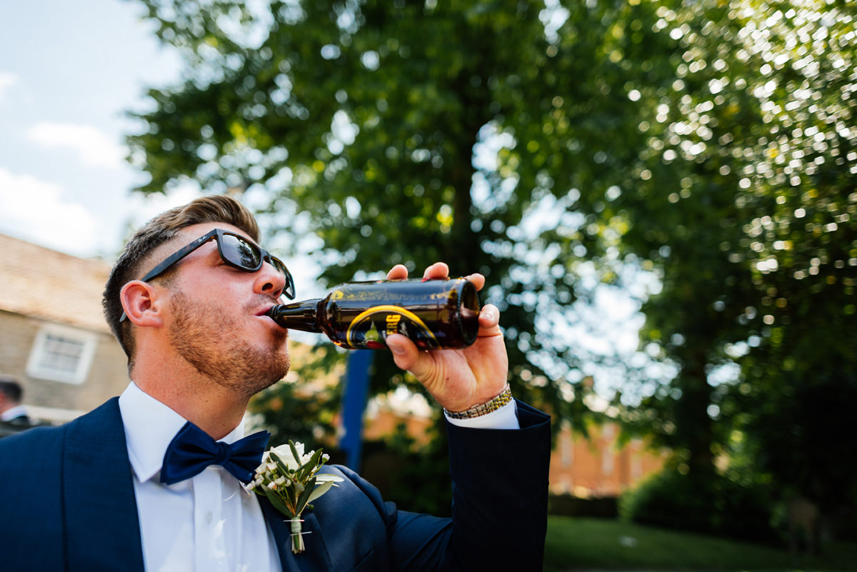 groom having a pre-ceremony drink
