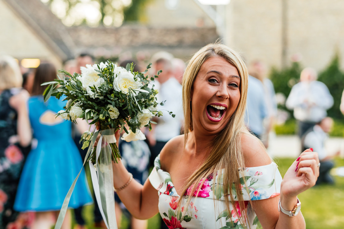 wedding guest caught the bouquet