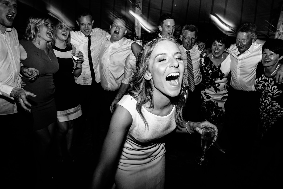 bride on the dance floor singing