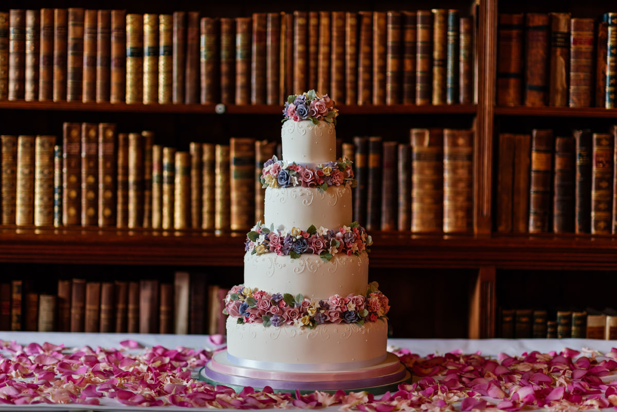 Wedding cake in front of bookcase