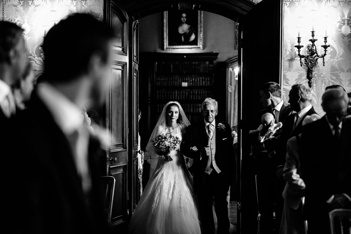 bride arriving with father down the aisle for the ceremony