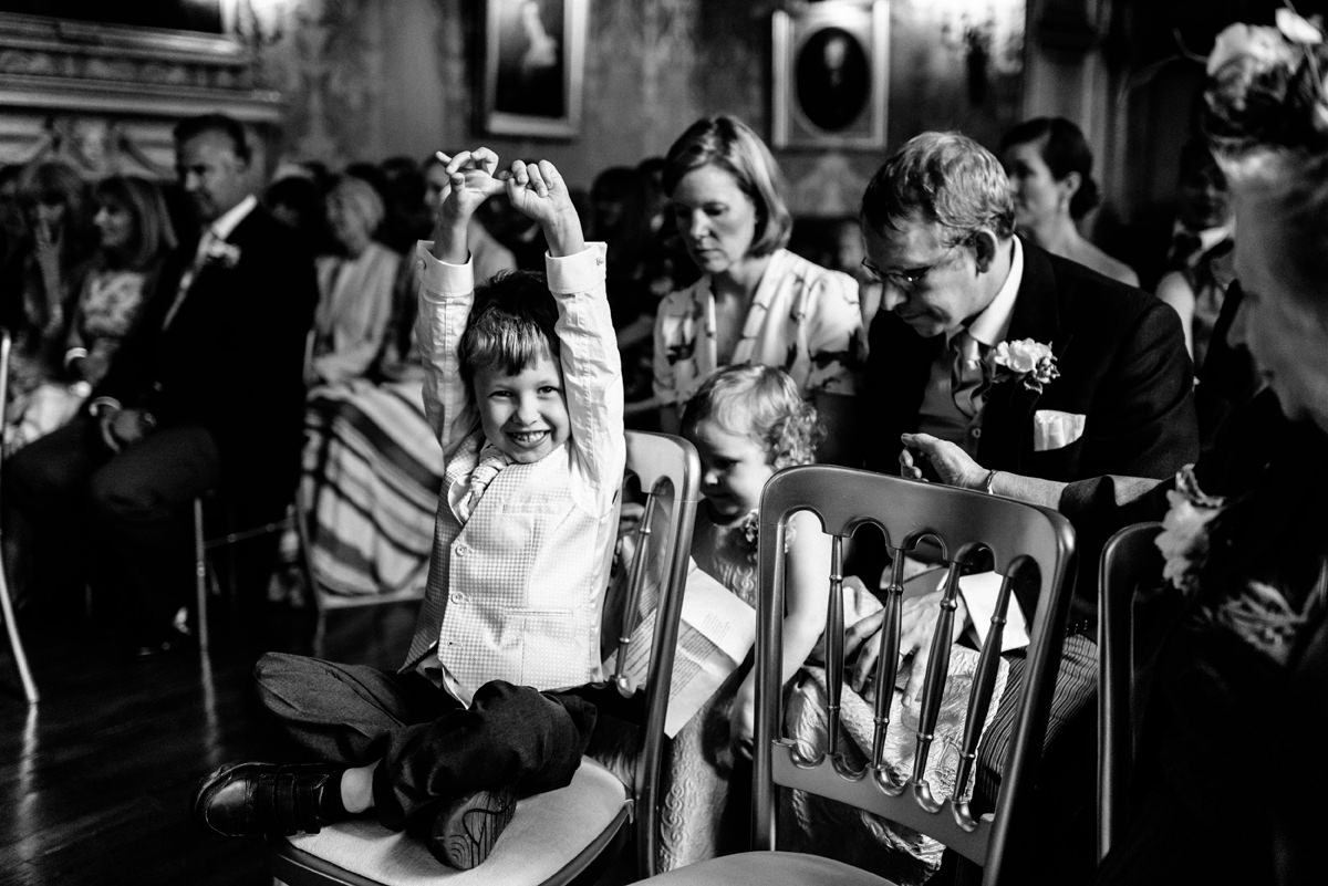 wedding guest young boy bored during wedding ceremony