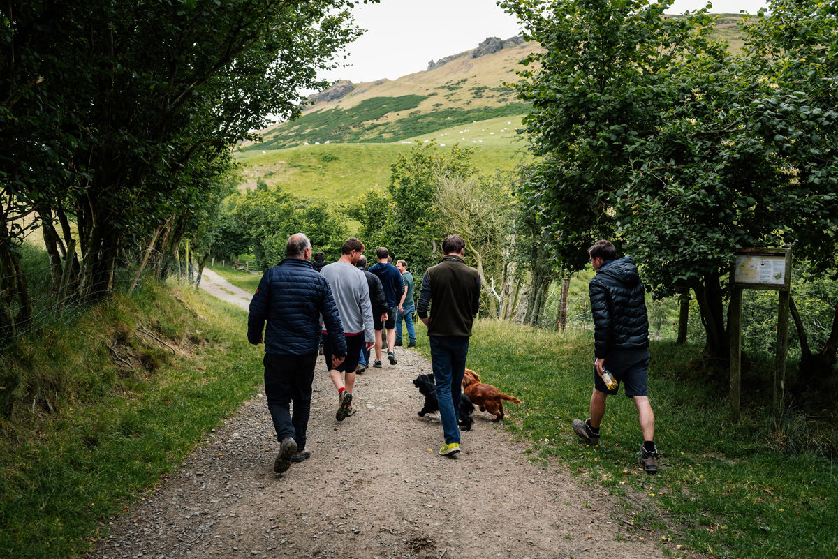 the groom and the boys head off for a walk in the shropshire hills