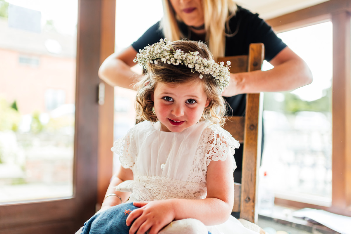 flower girl having her flower crown fitted