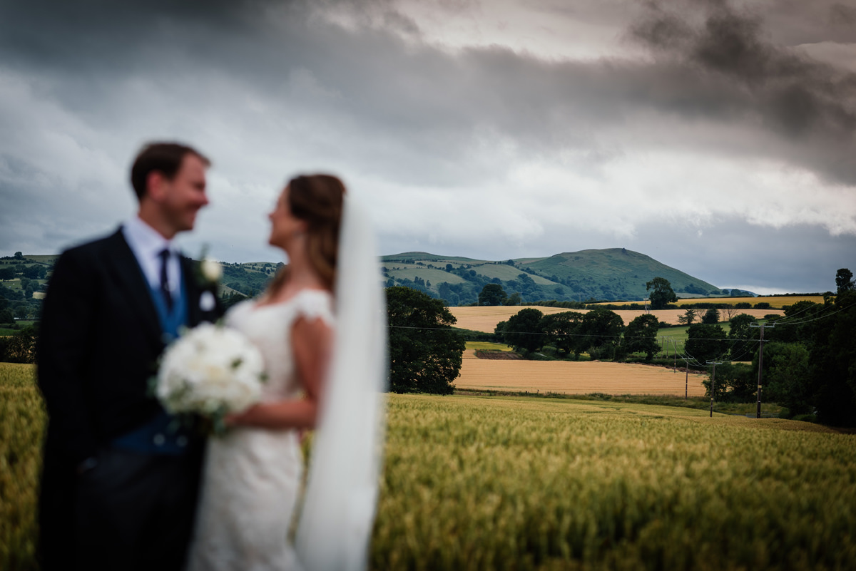 bride and groom portrait with the shropshire hills behind them