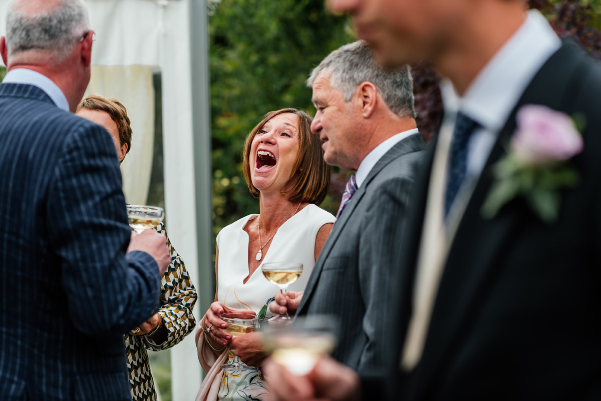 wedding guests having fun during the drinks reception
