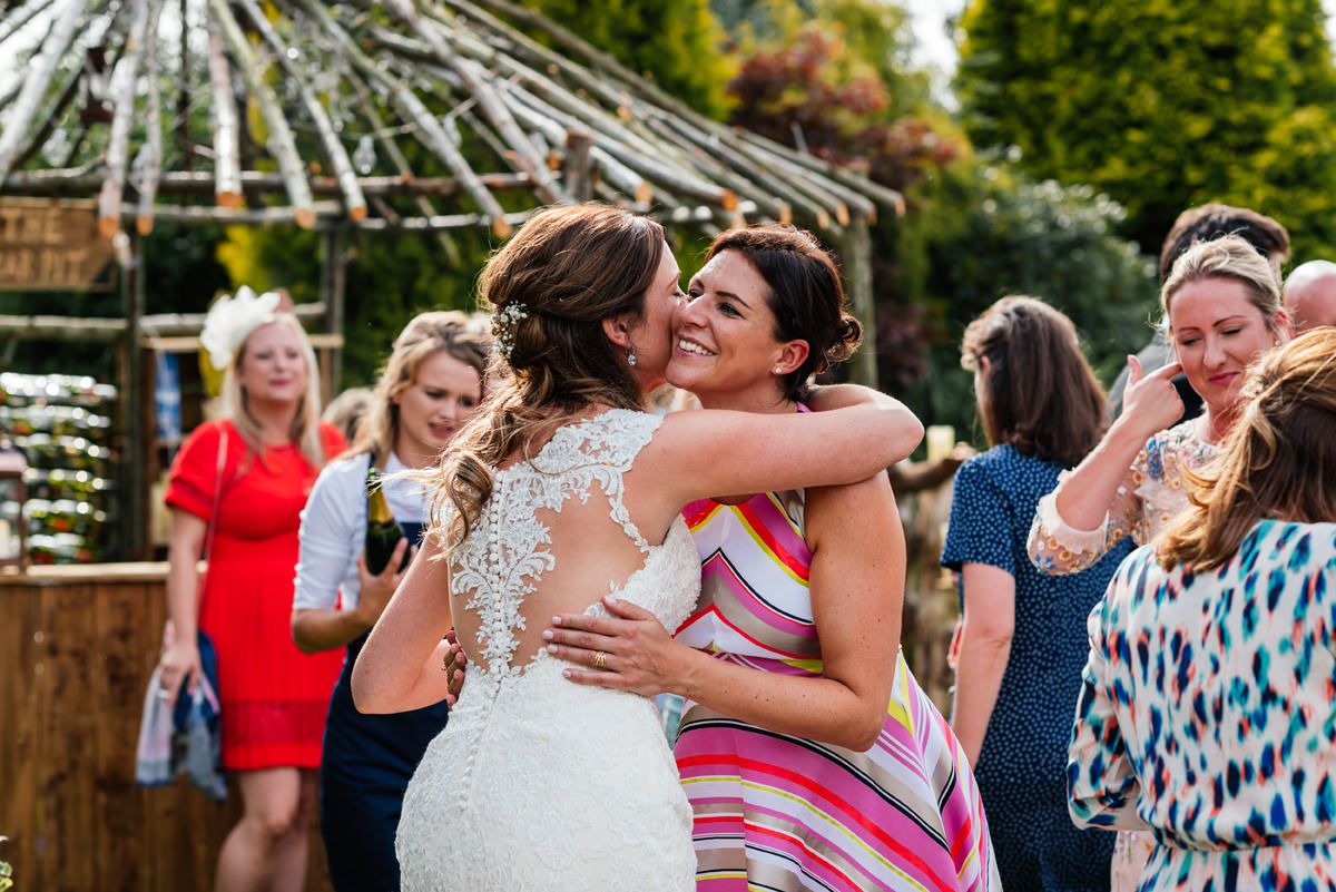 bride hugs a wedding guest